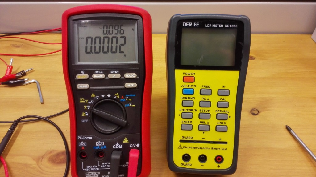 DE-5000 on the right. Size comparison to Brymen multimeter.